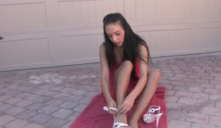 Stephanie Cane is naked on a towel. She is putting some lotion on her delicate skin. The solo girl pays special attention to her wet pussy and that babe fingers herself.