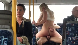 Blonde is on a bus with a dude. She does not wait for them to have to the apartment. She instead tears off her clothes and has sex in front of people. Massive tits.