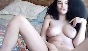 Russian dark brown breasty camgirl masturbating on webcam