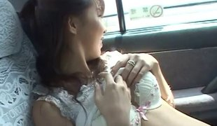 Oriental girl flashes in a car and receives group-fucked at home