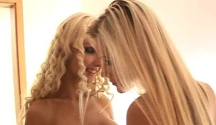 Blonde glamour babes play together in an erotic tease
