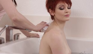 Short-haired redhead getting the oral treatment from her best friend