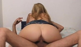 Jack Hammer gives a big breasted blond wife a deep fucking on the sofa