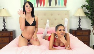Tanned beauty and her dark-haired friend using their perverted toys