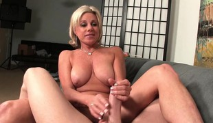 Busty golden-haired housewife Payton Hall offers her spouse a great tugjob
