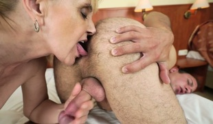 Salacious blonde granny Nanney enjoys anal sex with a hot guy