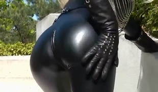Sexy blond lady black leather catsuit