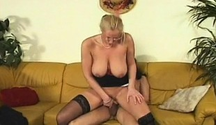 Busty blonde mommy in black nylons can't live without getting screwed by a hung guy
