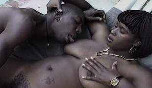 Black nympho receives her hairy peach screwed deep and hard by a dark stud