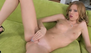 Blonde Angel Hott gives herself some pussy hole stimulation with the help of her fingers