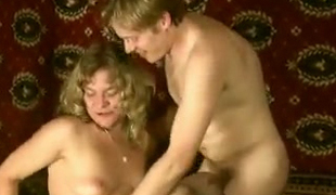 Golden-haired Russian amateur lady having party with her ally