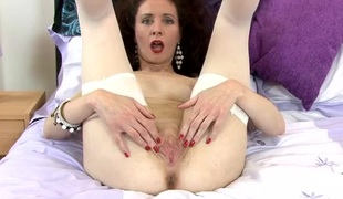 Hot mama in red lipstick plays with her soaked fur pie
