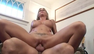 Milf with amazing fake bra buddies rides a young dick
