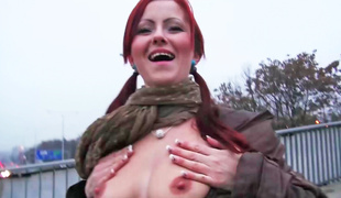 A hot redhead is penetrated anally in the bathroom