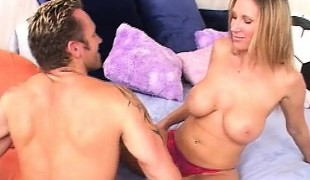 Horny blond soccer mama with large tits sucks and rides a hard cock in bed