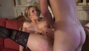 A breasty milf that has amazing knockers is getting penetrated hard