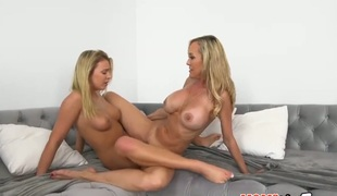 Blonde Brandi Love with giant melons and shaved cunt and Cali Sparks have a fun lesbo sex session they will never forget