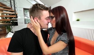 Gorgeous chick with glasses can't live without sucking on a swollen member